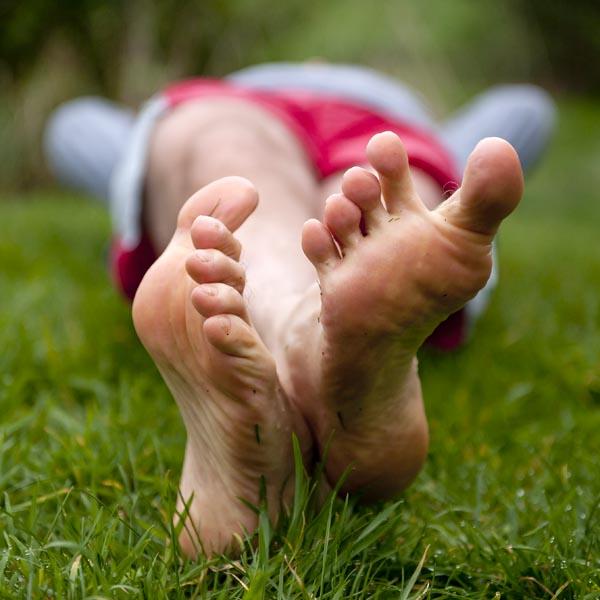 Pretty girl feet shoe dangle sole showing 4