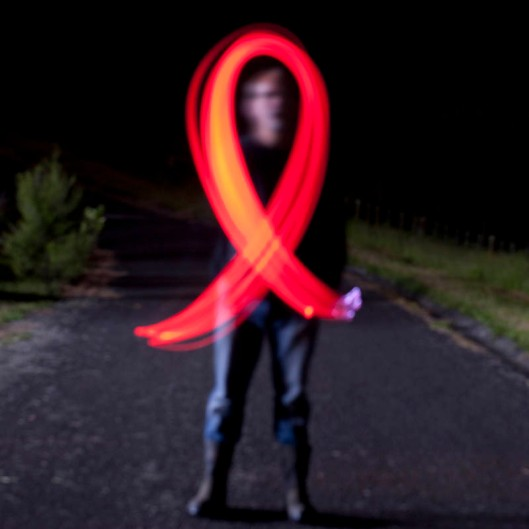 The red ribbon is the international symbol of HIV awareness.(© All Rights Reserved)