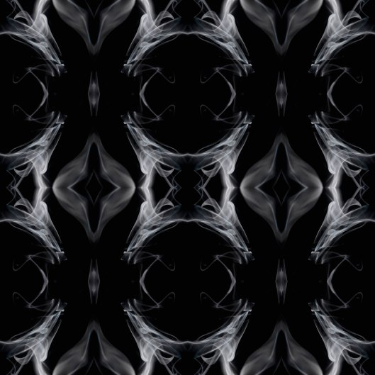 'Smoke and mirrors' - patterns created through repeated mirroring of candle smoke.(© All Rights Reserved)