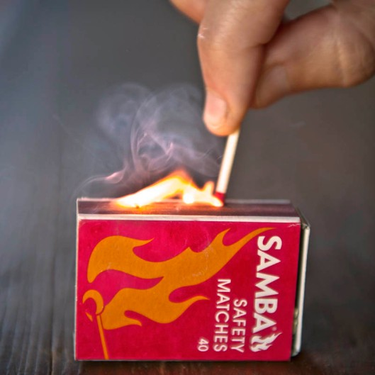 Lighting a modern day safety match - much safer than lighting John Walker's 1826 friction matches!  (© All Rights Reserved)