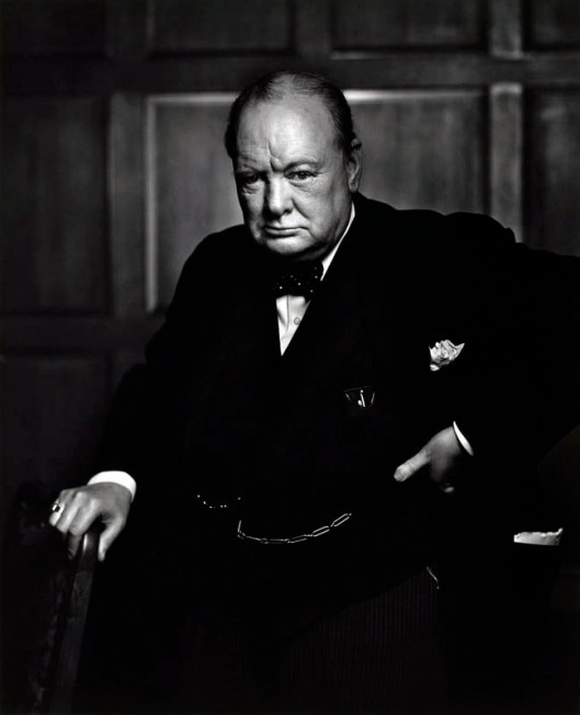 "The famous 1941 Karsh portrait of Winston Churchill. According to legend, Karsh only had a few minutes to photograph the great man - quite a daunting prospect. When Churchill entered the room where the portrait was to be taken, he appeared in a fowl mood, seemingly less than keen on the photo shoot. This attitude actually suited Karsh, who relished the challenge to capture his subject's character in his photographs. However, he thought the fact that Churchill had a cigar stuck between his teeth wouldn't work in the portrait, so he instinctively reached out and removed the cigar. This really aggrevated Churchill - his scowl deepened, he thrust his head forward and he angrily placed his hand on his hip. Noticing that this was the perfect moment, Karsh took the picture, and immortalised Churchill in a pose of unconquerable defiance. Despite being difficult during the shoot, Churchill acknowledged Karsh's photographic mastery - he is quoted as saying ""You can even make a roaring lion stand still to be photographed."" This prompted Karch to title the portrait 'The Roaring Lion'."